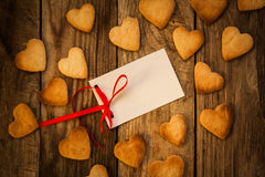 Valentine`s day. On the White Isolated Letter and Gingerbread Cookies in the Shape of Heart at Valentine Day. On the wooden background Stock Image