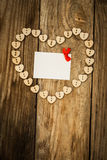 Valentine`s day. On the White  Letter and Нeart from buttons on a wooden background. Valentine`s day Stock Photography