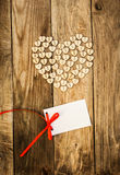 Valentine`s day. On the White  Letter and Нeart from buttons on a wooden background. Valentine`s day Stock Images