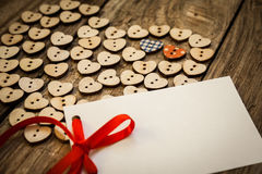 Valentine`s day. On the White  Letter and Нeart from buttons on a wooden background. Valentine`s day Stock Photos