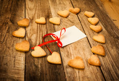 Valentine`s day. On the White  Letter and Gingerbread Cookies in the Shape of Heart at Valentine Day. On the wooden background Stock Images