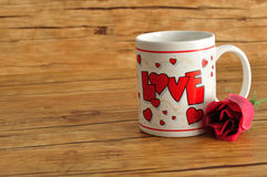 Valentine`s Day. A white mug with the word love on it royalty free stock image