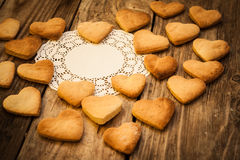 Valentine`s day. White napkin and  Cookies in the Shape of Heart at Valentine Day. On the wooden background Stock Images