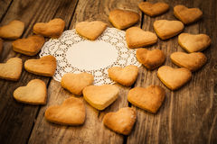 Valentine`s day. White napkin and  Cookies in the Shape of Heart at Valentine Day. On the wooden background Stock Photos