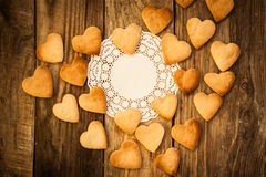 Valentine`s day. White napkin and  Cookies in the Shape of Heart at Valentine Day. On the wooden background Stock Image