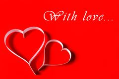 Valentine's day - white paper hearts on red background Stock Images
