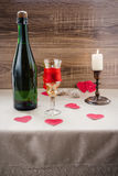 Valentine`s Day. wine, candles, small heart. On the wooden background Royalty Free Stock Photo