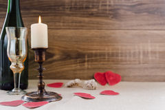 Valentine`s Day. wine, candles, small heart. On the wooden background Stock Images