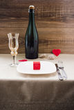 Valentine`s Day. wine, candles, small heart. On the wooden background Royalty Free Stock Image