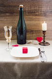 Valentine`s Day. wine, candles, small heart. On the wooden background Royalty Free Stock Photos