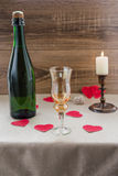 Valentine`s Day. wine, candles, small heart. On the wooden background Stock Photography