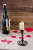 Valentine`s Day. wine, candles, small heart. On the wooden background Stock Photo