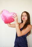 Valentine's day.  Woman with a big red. Beautiful woman with a big red heart Stock Photography