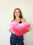Valentine's day. Woman with a big red. Beautiful woman with a big red heart Stock Photo