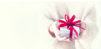 Valentine`s Day. Woman holding gift box royalty free stock images