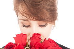 Valentine's Day. A young woman lookls down at her at her roses Stock Photo