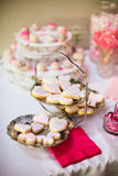Valentine's Dessert Party Table. Valentine's sugar heart cookies in a vintage silver tray on a themed dessert table at a party Stock Photos