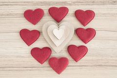 Valentine's fabric and wooden hearts on a wooden background Royalty Free Stock Image