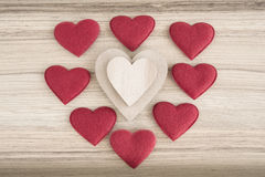 Valentine's fabric and wooden hearts on a wooden background Royalty Free Stock Photography