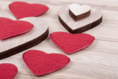 Valentine's fabric and wooden hearts on a wooden background Stock Photography