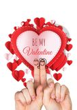 Valentine`s fingers love couple and Be my Valentine text and Paper Valentines hearts in circle shape. Digital composite of Valentine`s fingers love couple and Be Royalty Free Stock Photography
