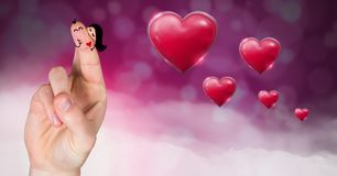Valentine`s fingers love couple and Shiny bubbly Valentines hearts with purple bokeh misty backgroun. Digital composite of Valentine`s fingers love couple and Royalty Free Stock Images