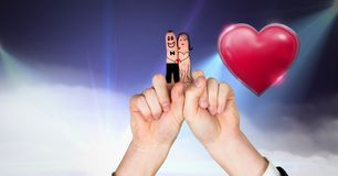 Valentine`s fingers love couple and Shiny heart glowing with purple misty lights flares background. Digital composite of Valentine`s fingers love couple and Royalty Free Stock Photos