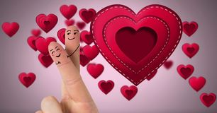 Valentine`s fingers love couple and Stitched Valentines Heart. Digital composite of Valentine`s fingers love couple and Stitched Valentines Heart Stock Photo