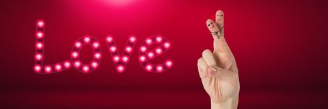 Valentine`s fingers love couple and Love text glowing neon light bulbs in pink room. Digital composite of Valentine`s fingers love couple and Love text glowing Royalty Free Stock Photos
