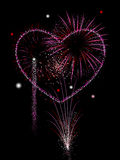Valentine's fireworks display. Valentine's Day Fireworks in pink and red Stock Photo