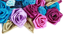 Valentine's frame. Blue, vinous, pink and turquois handmade silk roses on white background with copy space below Stock Image