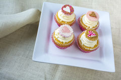 Valentine's french vanilla cupcake with colorful fondant heart t Royalty Free Stock Photo