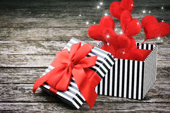 Valentine's gift box with red hearts Royalty Free Stock Images