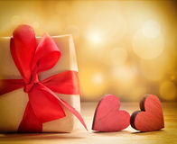 Valentine's gift with red wooden hearts Royalty Free Stock Images