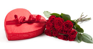 Valentine's gifts including a bouquet of roses and candy heart Stock Photos