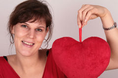 Valentine's Heart. A young beautiful woman with her valentine's plush heart Royalty Free Stock Photo