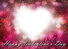 Valentine& x27;s heart bokeh on dark pink background Royalty Free Stock Images