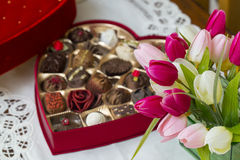 Valentine's Heart Box with Chocolate Confections & Tulip Flowers. Stock Photo