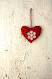 Valentine's heart hand made on a old wooden door. Heart symbol  hand made on a old wooden background Stock Photos