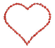 Valentine's heart made of pomegranate seeds Stock Images