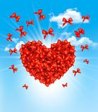 Valentine's heart made of red bows. Royalty Free Stock Photography