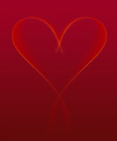 Valentine's Heart Ribbon of Light. Deep red background with a glowing ribbon of light tracing out the shape of a heart Royalty Free Stock Photos