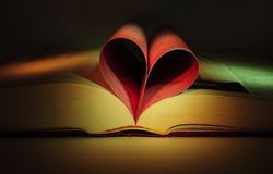 Valentine's heart shaped book. Heart shape made of a book pages with red and green lights Royalty Free Stock Photography