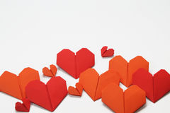 Valentine's heart shaped folded papers. Pattern of Valentine's heart shaped folded papers, isolated on white background Royalty Free Stock Image