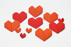 Valentine's heart shaped folded papers. Pattern of Valentine's heart shaped folded papers, isolated on white background Royalty Free Stock Photo
