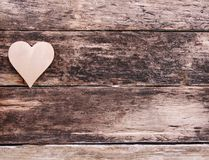 Valentine-s heart on weathered wooden background. Rough natural boards texture stock photo
