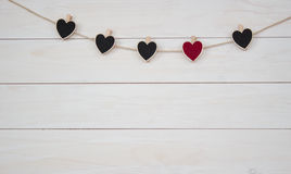Valentine`s hearts hangin on natural cord Wooden white background. Valentine`s Day. Love hearts gangin on natural cord Stock Photos