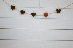 Valentine`s hearts hangin on natural cord Wooden white background. Retro style. Valentines, hearts, hangin, on natural cord Wooden white background Stock Photography