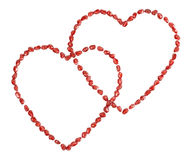Valentine's hearts made of pomegranate seeds Royalty Free Stock Photo