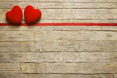 Valentine`s hearts on wooden table with red ribbon Royalty Free Stock Photography